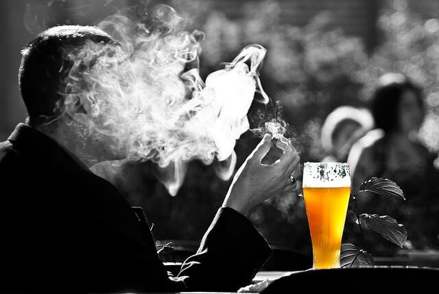 man smoke drink alcohol