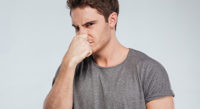 covering mouth due to bad breath
