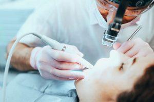 dentist fixing broken tooth